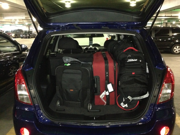 Team Titleist doesn't travel light. The rental...
