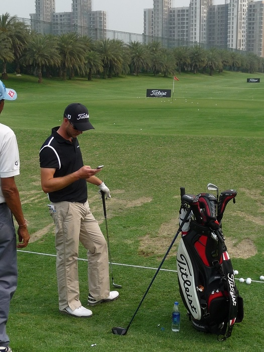 Aussie Titleist ambassador Kieran Pratt checks his...