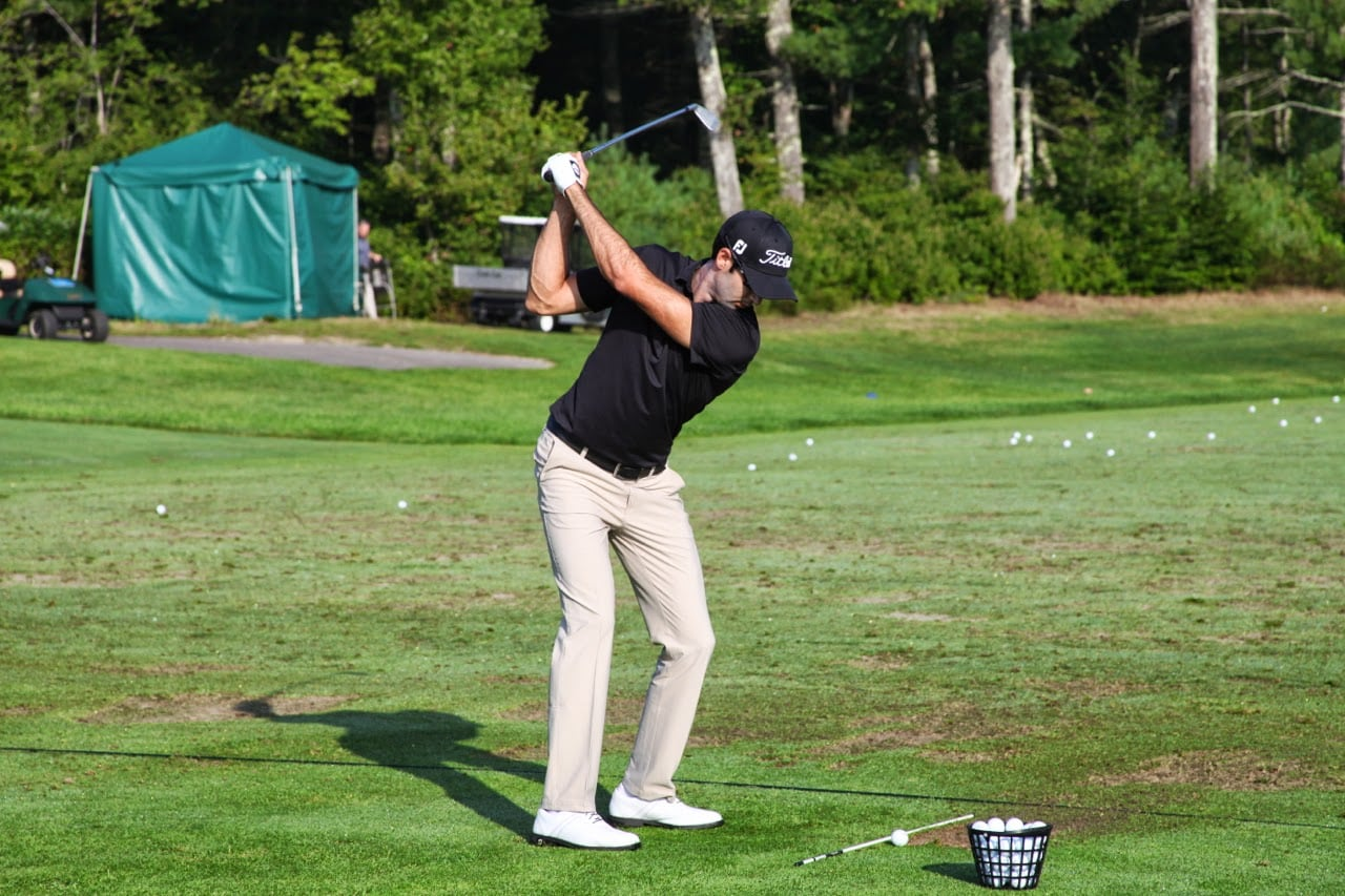 a stable top of the backswing over his Titleist...