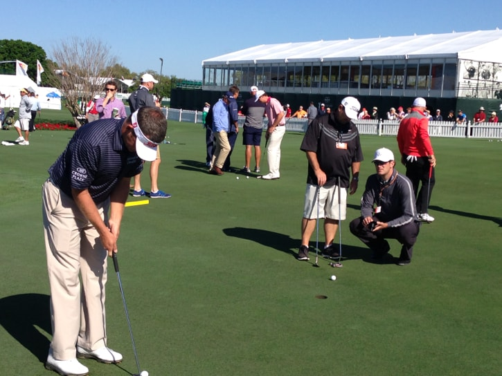 Jason Bohn working with the Scotty Cameron team.