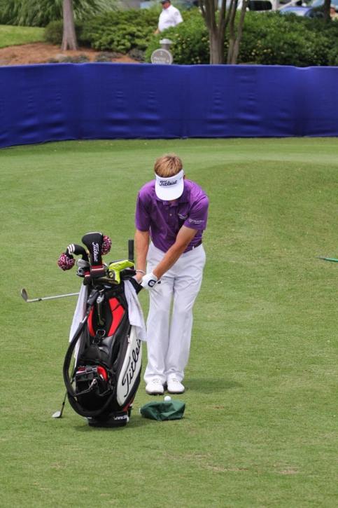 Putting his Vokey Design wedges to work.