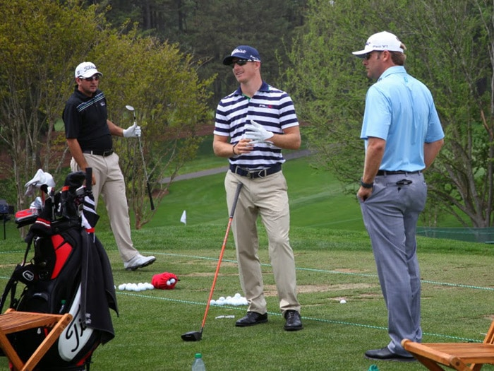 On the range, Morgan warms up next to fellow...