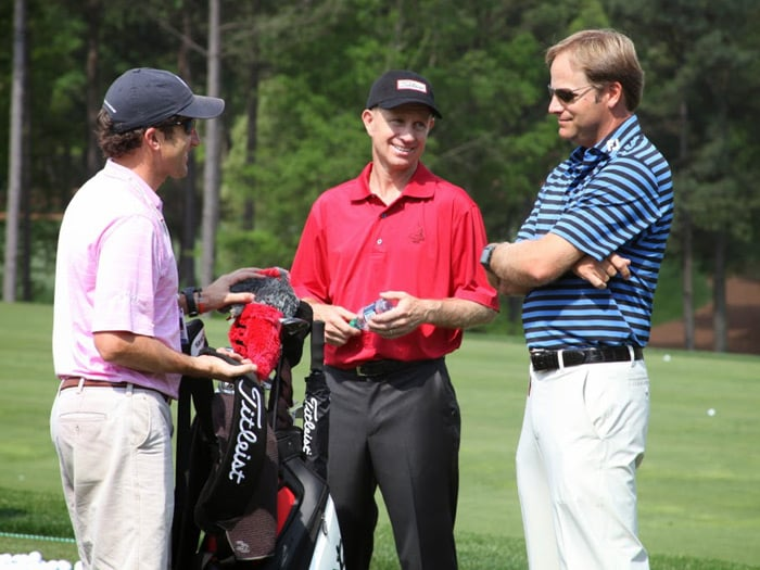 Titleist staff member Kelly Mitchum (center) chats...