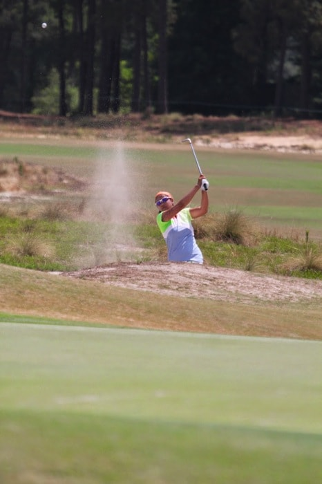 works on her approach shots from one of the many...