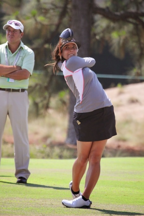Pro V1x loyalist Maria Jo Uribe with her coach on...