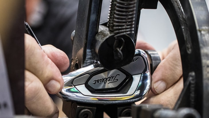 A prototype Titleist 718 AP3 iron has work done in...