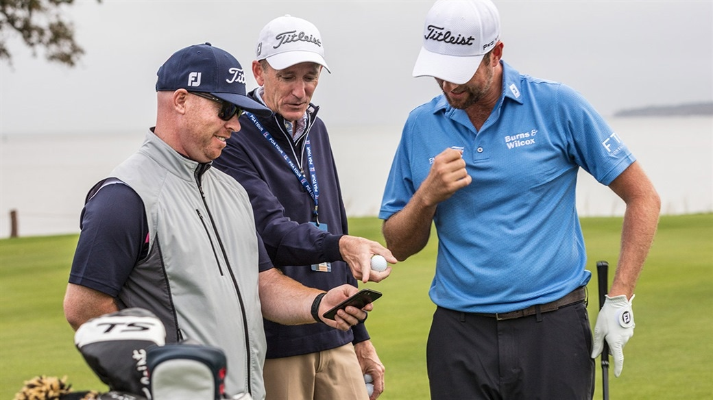 Titleist tour reps JJ Van Weezenbeeck and Fordie Pitts review spin and launch numbers during golf ball testing with Webb Simpson in 2019.