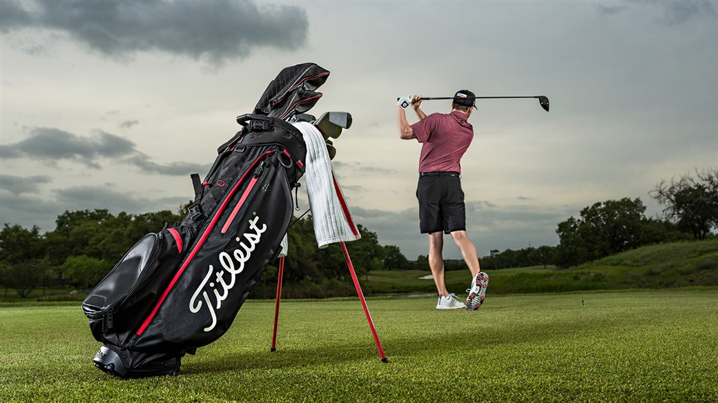 Amateur golfer using a new Players 4 StaDry golf bag from the Titleist Jet Black Collection