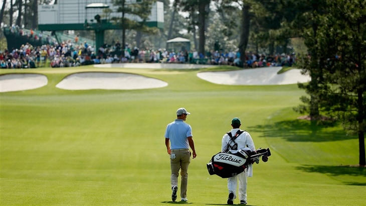 Adam Scott and his caddie walking the fairways of Augusta National Glf Club during action at The Masters